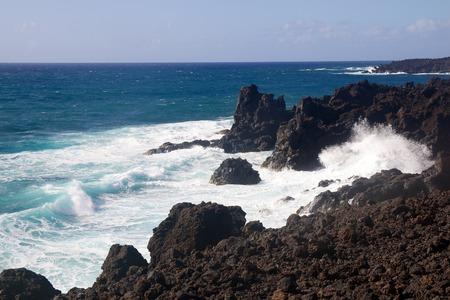 Wild sea and volcanic lava rocks at the Los Hervideros west coast of Lanzarote island, Spain Stock Photo - 28177690