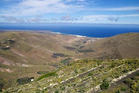 Traditional vineyards in the barren volcanic landscape of Lanzarote island, Spain Stock Photo - 28177699