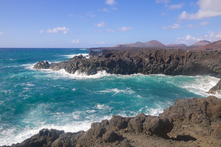 Wild sea and volcanic lava rocks at the Los Hervideros west coast of Lanzarote island, Spain Stock Photo - 28181710