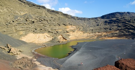 golfo: View into a volcanic crater with its green lake near El Golfo, Lanzarote island, Spain Stock Photo