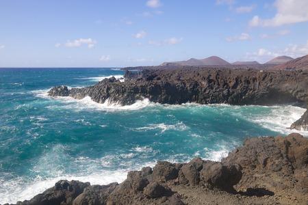 Wild sea and volcanic lava rocks at the Los Hervideros west coast of Lanzarote island, Spain