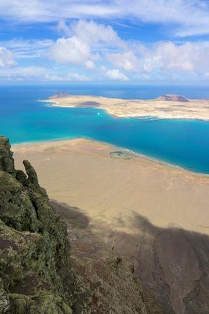 Amazing view on the volcanic coastline and Isla Graciosa from Mirador del Rio vista, Lanzarote, Spain Stock Photo - 28341735