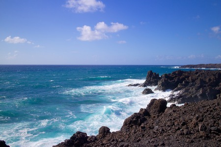 Wild sea and volcanic lava rocks at the Los Hervideros west coast of Lanzarote island, Spain Stock Photo - 28341524