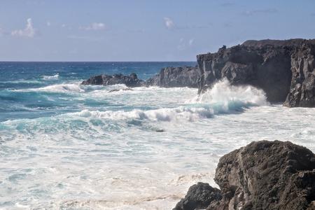 Wild sea and volcanic lava rocks at the Los Hervideros west coast of Lanzarote island, Spain Stock Photo - 28603756