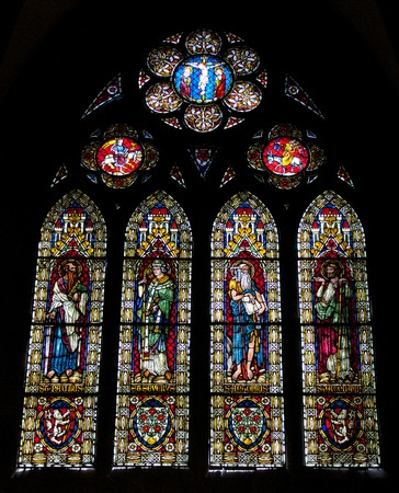 Beautiful stained glass window in the famous gothic cathedral of Freiburg city, Germany