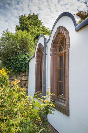 seepark: Brimstone window frames behind a nice garden