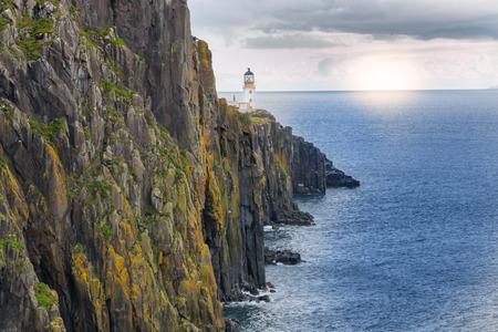 Lighthouse on the cliffs of Neist Point, a famous landmark near Glendale, Isle of Skye, Scotland