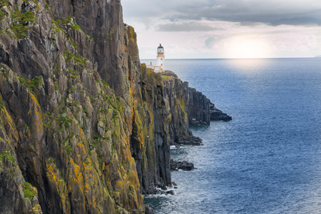 Lighthouse on the cliffs of Neist Point, a famous landmark near Glendale, Isle of Skye, Scotland