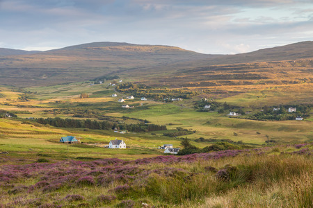 View over Glendale village in a valley between Highland hills on the Isle of Skye, Scotland photo