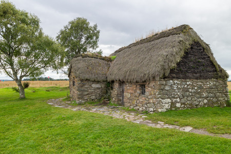 eighteenth: Eighteenth century thatch roof stone cottage on the famous battlefield of Culloden, Scotland