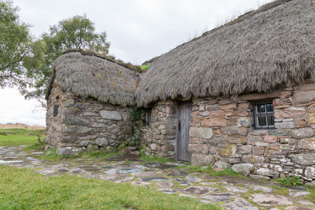 jacobite: Eighteenth century thatch roof stone cottage on the famous battlefield of Culloden, Scotland
