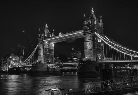 london tower bridge: Dramatic black and white image of the London Tower Bridge at night, HDR version