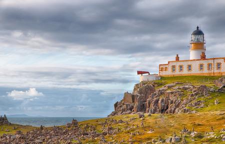 Lighthouse on the cliffs of Neist Point, a famous landmark near Glendale, Isle of Skye, Scotland photo