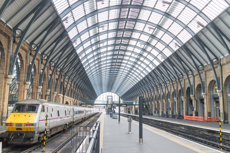 Platforms and train in Kings Cross railway station, London, England