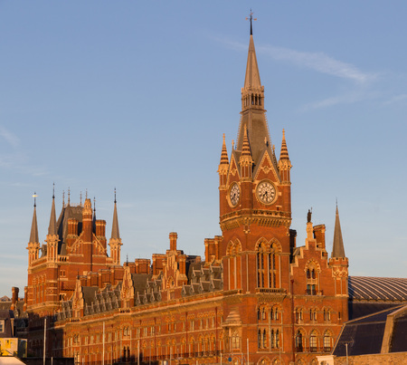 pancras: Famous red London St. Pancras railway and subway station in the warm morning light Stock Photo