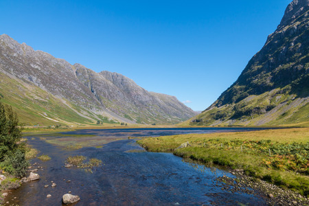 View over the amazing landscape of Glencoe, a world famous valley in Scotland photo