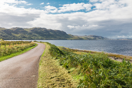 Road along the coast of the Scottish Highlands photo