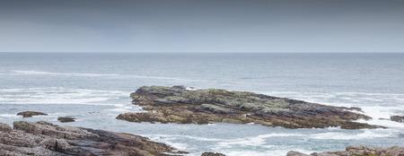 View onto the rocky coastline of the Isle of Skye, Scotland, UK photo