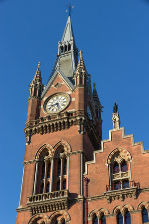 pancras: Close-up shot the clock-tower of famous St. Pancras railway station in London, England