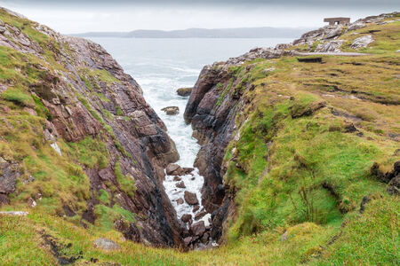 View onto the rocky coastline of the Isle of Skye, Scotland, UK photo