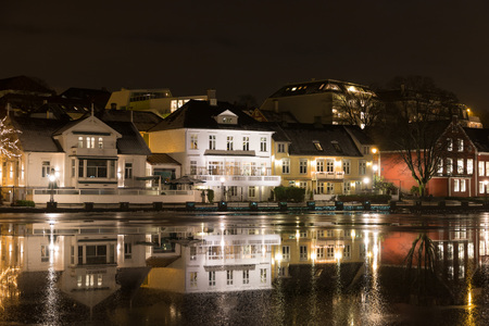 Stavanger city lake Breiavatnet with the Stavanger cityscape in the background at night photo