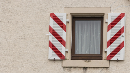 Window and shutters on the facade of an old residence in the heart of Freiburg, Germany photo