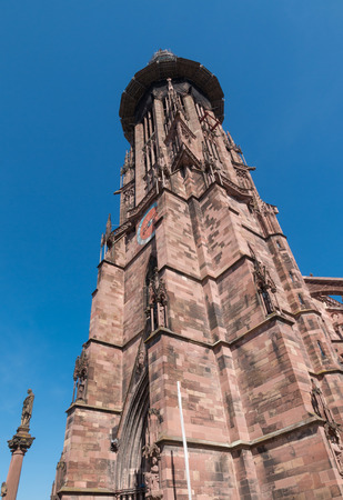 wold: Exterior of wold famous Freiburg Münster cathedral, a medieval church in the city of Freiburg, Germany, at the edge of the Black Forest