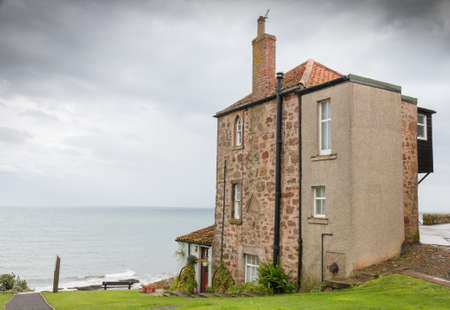 fife: Typical British apartment building on the rough shores of Crail, Fife, close to St. Andrews, Scotland