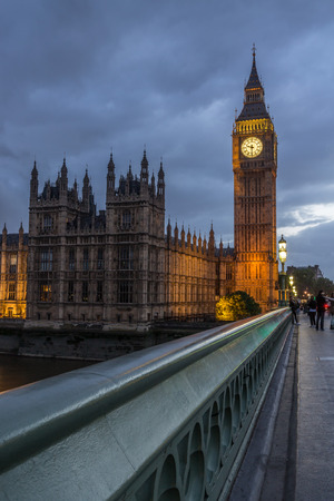 nicknamed: World famous clock tower of the British Houses of Parliament, nicknamed Big Ben, as seen from Westminster Bridge at night