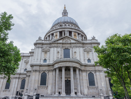 Wolrd famous St. Paul's Cathedral with its columns, statues and ornaments, close to the River Thames, London
