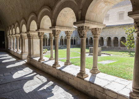 Cloister and archway of famous medieval Girona cathedral, Catalonia, Spain