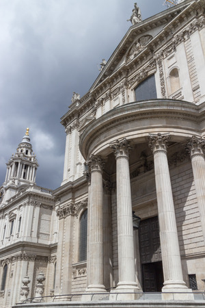 st pauls cathedral: Wolrd famous St. Pauls Cathedral with its columns, statues and ornaments, close to the River Thames, London