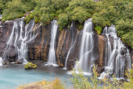 Long exposure shot of famous Hraunfossar waterfalls and cascade, a popular tourist destination in western Iceland Stock Photo