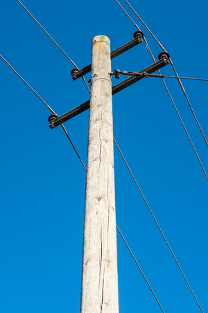 electricity providers: Closeup shot of an old power line on a wooden pole Stock Photo