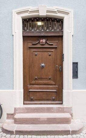 ornamented: Old doorway to a municipality building in the old town of Freiburg city, Germany