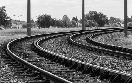 bended: Monochromatic image of a bended railway track through a rural area in Germany Stock Photo