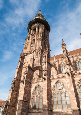 freiburg: Main tower of world famous Freiburg Muenster cathedral, a medieval church in the city of Freiburg, Germany, at the edge of the Black Forest