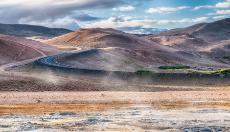 lonesome: Lonesome road to the Hverir solfatara fields in Kafla mountains, Iceland, HDR