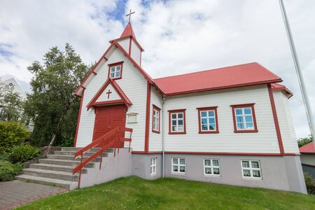 small roof: Small wooden church with red roof, typical for Iceland, in the city of Akureyri