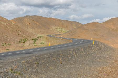 lonesome: Lonesome road to the Hverir solfatara fields in the desert-like Kafla mountains near Lake Myvatn, Iceland