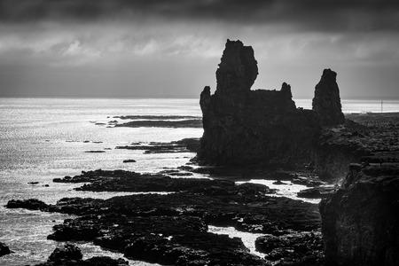 south coast: Strange lava formations, called Londrangar, at the south coast of Snaefellsnes peninsula, Iceland, monochromatic version
