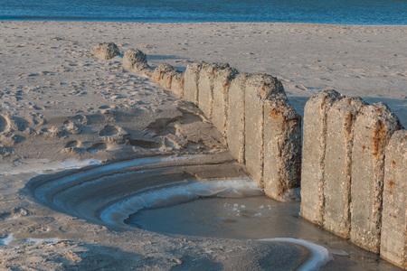 bulwark: Old row of stones, built as a breakwater on the western beach of Sylt island, Germany Stock Photo