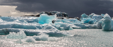 water frozen: Icebergs swimming on world famous Jokulsarlon glacier lagoon in southern Iceland