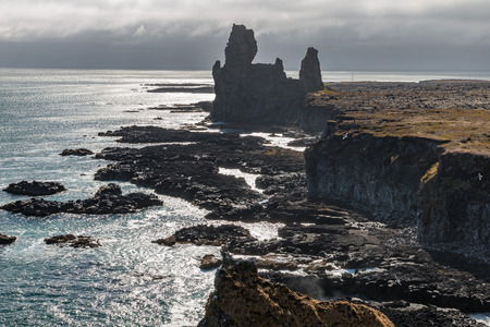 Strange lava formations, called Londrangar, at the south coast of Snaefellsnes peninsula, Iceland