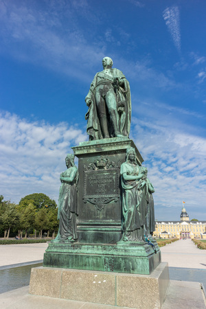 Statue of Carl Friedrich von Baden, founder of the City of Karlsruhe, Germany, in front of famous Karlsruhe Castle Editorial