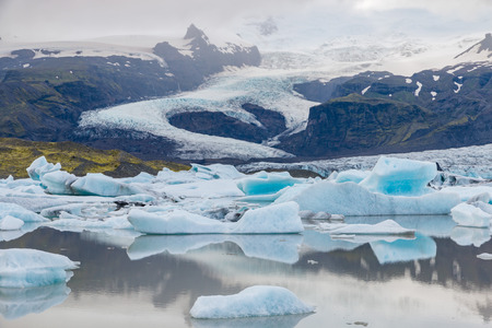 Famous Fjallsarlon glacier and lagoon with icebergs swimming on the water, close to Jokulsarlon, southern Iceland