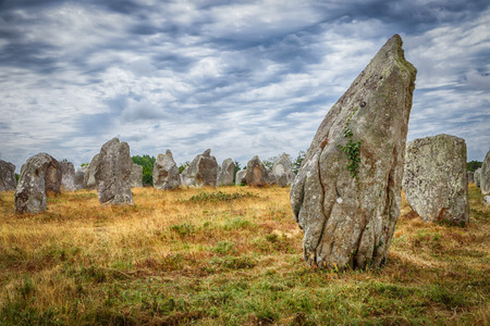 Ancient standing stones of Carnac, Brittany, northern France, a mysterious collection of huge stones from the neolithic age, HDR version 스톡 콘텐츠