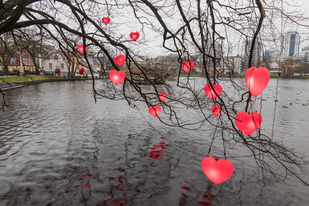Valentines day installation of hearts above the waters of a lake Stock Photo