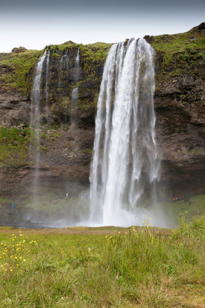 World famous Seljalandsfoss, a majestic waterfall in southern Iceland, coming down over a cliff, fed by a glacier