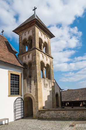Daytime shot of famous Comburg monastery tower above the city of Schwaebisch-Hall, southern Germany Stock Photo